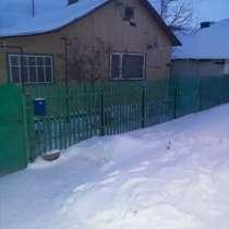 Продается дом с гаражом и баней, в Октябрьского