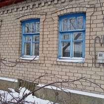 Продажа земельного участка с домом и гаражем, в г.Енакиево