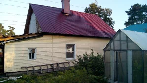 Продам дом из бревна обшитый сайдингом