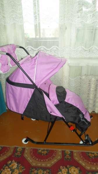 Санки-коляска розовые