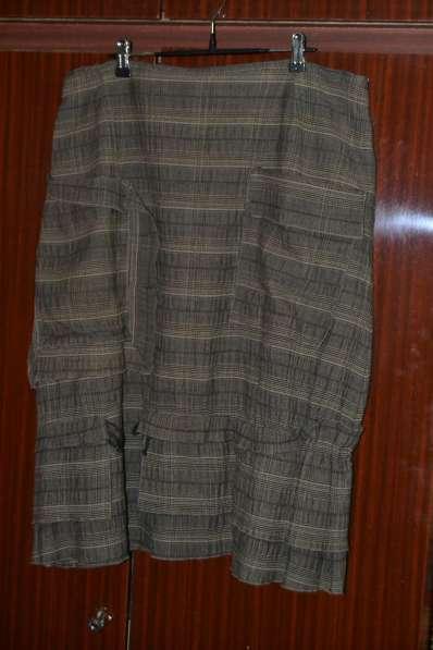 Юбка в клетку с накладными карманами