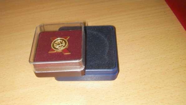 Футляры для значков и медалей.