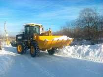 Уборка снега в Первомайском и Советском районах - Россия , Н, в Новосибирске