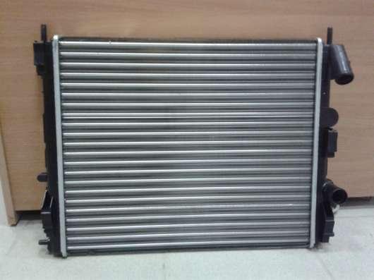 Новый радиатор на Рено Логан с 2007 г 583809X