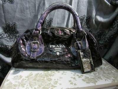 сумку Prada