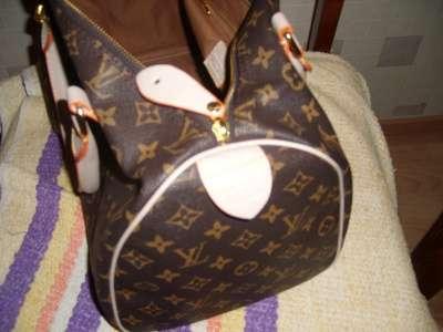 сумку Louis Vuitton