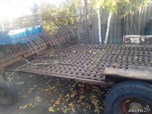 косарка и грабли для трактора