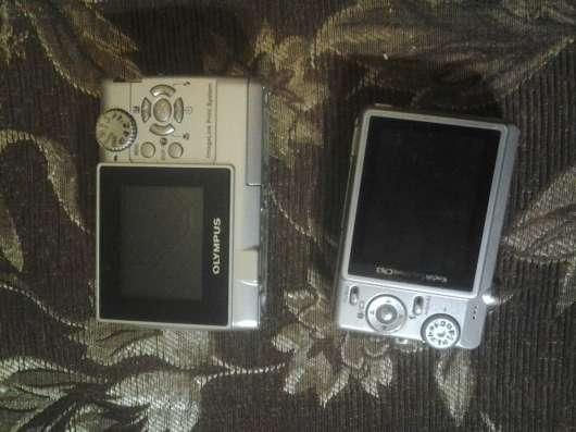 Цифровые фотоаппараты Олимпус и Кодак