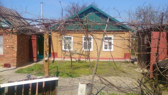 В г.Кропоткине по ул.Ленина дом турлучный, обложенный кирпичом 51 кв.м.