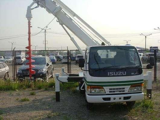 Ямобур Isuzu ELF ( услуги по бурению БКМ)