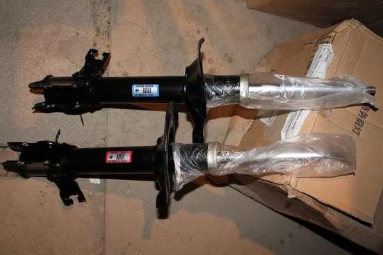 Амортизатор X-TRAIL передний правый, левый 54302-EQ025