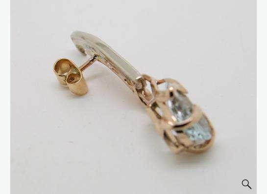 Золотая брошь с Аквамарином и бриллиантами.